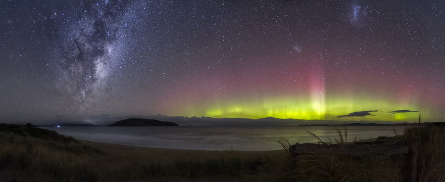 Beautiful display of the Aurora Australis or Southern Lights with the galactic centre of the Milky Way