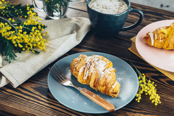 Continental traditional breakfast with croissants and coffee