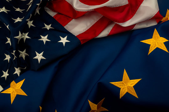TTIP, USA and EU cooperation and Transatlantic Trade and Investment Partnership concept theme with the flags of the United states of America and the European Union\