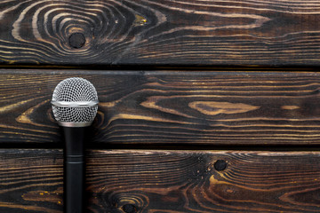 blogger, journalist or musician office desk with microphone on wooden background top view copyspace