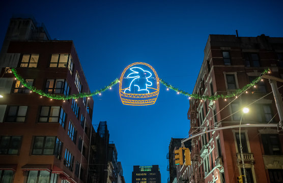 Neon eastern rabbit at night on the street in Little Italy district, New York