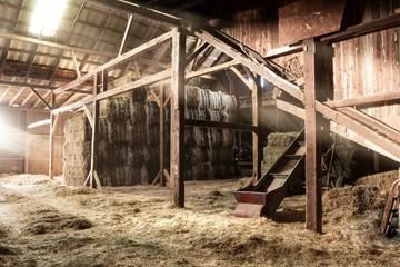 Foto auf Acrylglas Alte verlassene Gebäude Barn Interior Wooden Light Beams Hay Bales Rustic