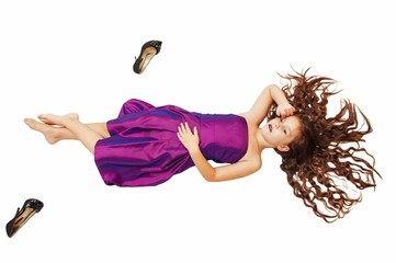 Little beautiful glamor girl in a beautiful evening lilac dress, with long hair with high-heeled shoes, isolate on white