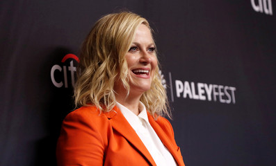 """Cast member Poehler poses at an event for the 10th anniversary of the television series """"Parks and Recreation"""" during PaleyFest LA in Los Angeles"""