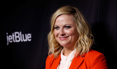 "Cast member Poehler poses at an event for the 10th anniversary of the television series ""Parks and Recreation"" during PaleyFest LA in Los Angeles"
