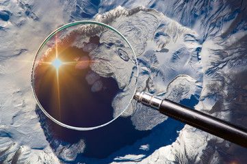 Mount Nemrut, Turkey, exploring through a magnifier. Elements of this image furnished by NASA.