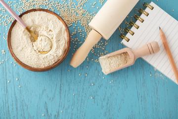 Quinoa flour in bowl, gluten free baking background