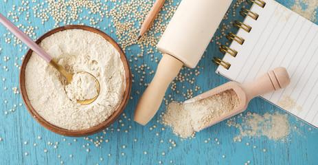 Gluten free baking with quinoa flour in wooden bowl