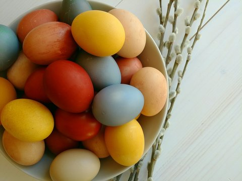 Natural dyed eggs with items from pantry. Easter holiday.