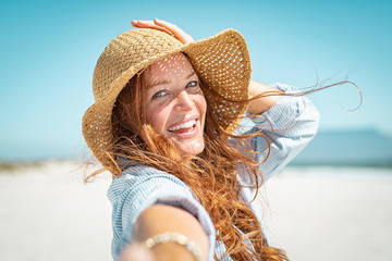Smiling mature woman with straw hat