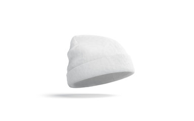 Blank white knitted beanie mock up, isolated, depth of field, 3d rendering. Empty casual headgear mockup. Clear fashion tuque for cold weather template.
