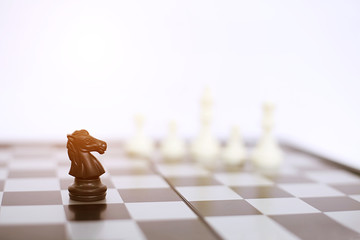 Picture of chess black horse on the chess board. Isolated on the white background.