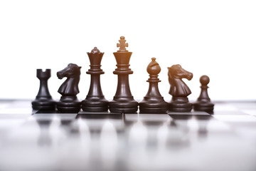 Picture of black pawns of a chess board. Isolated on the white background.