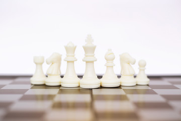 Picture of chess board game with white chess pawns. Isolated on the white background.