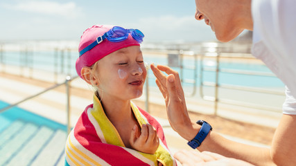 Girl getting skin care after swimming lessons