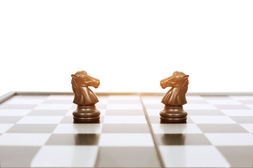 Picture of black two horse pawns on the chess board game. Isolated on the white background.
