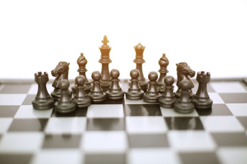 Picture of chess black pawns on the chess board game. Isolated on the white background.