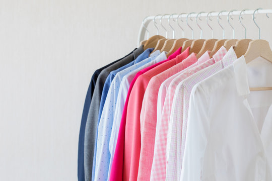 Different colored shirts hanging on rack