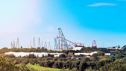 Image of red and blue roller coasters.