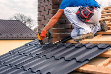 roof master repairs the roof