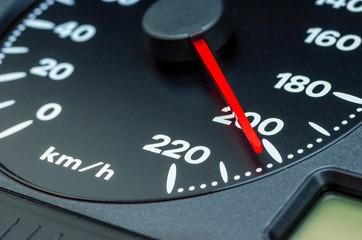 Close up shot of a speedometer in a car, 200 km/h