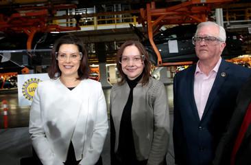 General Motors Chief Executive Mary Barra poses for a photograph with Michigan Governor Gretchen Whitmer and United Auto Workers union Vice President Terry Dittes at the GM Orion Assembly Plant in Lake Orion