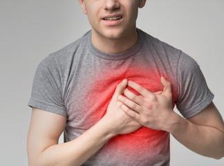 Young man having heart attack. healthcare concept