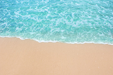 Wall Mural - Soft blue ocean wave and water sea clear on clean sandy beach