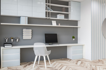 Side view of modern home office, computer desk