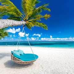 Fototapete - Tropical beach background as summer landscape with beach swing or hammock and white sand and calm sea for beach banner. Perfect beach scene vacation and summer holiday concept. Boost up color process