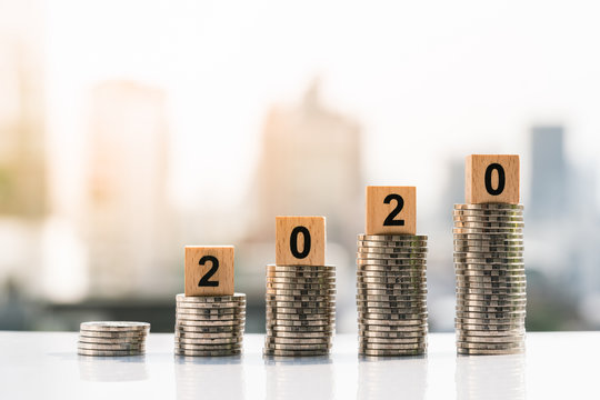 Money, Financial, Business Growth concept. 2020 wooden blocks on top of coin stack on city backgrounds.
