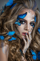 Girl with butterflies in her hair and gorgeous eye makeup
