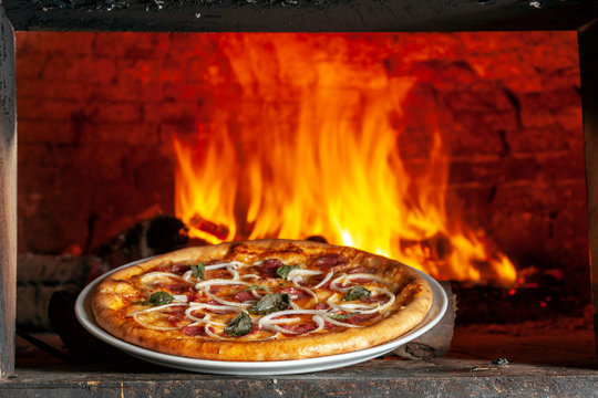 Baked pizza in the wood oven
