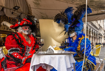 Italy, Venice, carnival 2019, typical masks, beautiful clothes, posing for photographers and tourists in Piazza San Marco.