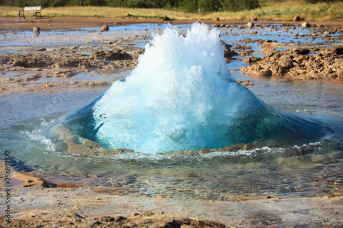 The turquoise blue boiling bubble of Strokkur Geyser In Iceland