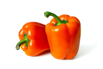 Two orange bell peppers