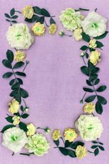 Romantic, pale yellow roses on light pink fabric background