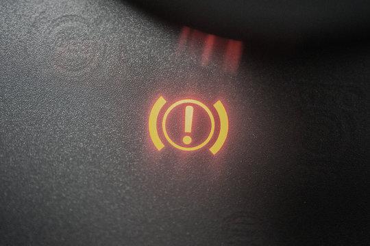 Handbrake warning light sign illuminated close up