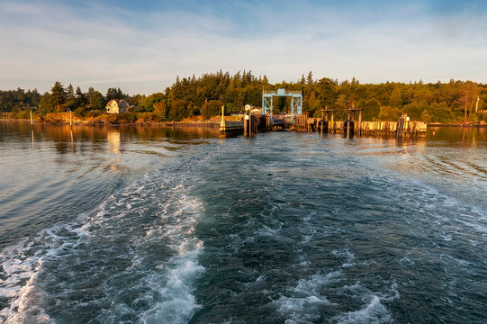 """Ferryboat Leaving the Lummi Island Ferry Dock in the San Juan Islands of Puget Sound. The """"Whatcom Chief"""" sails from Lummi Island to Gooseberry Point near Bellingham, Washington."""