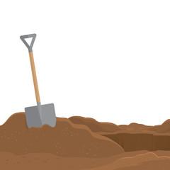 Shovel stuck in the soil isolated