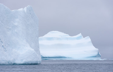 Two Large Icebergs Afloat in the Southern Ocean