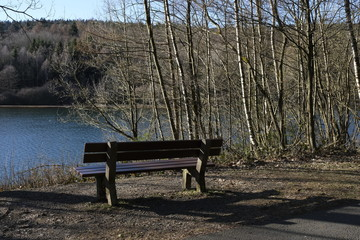 Empty bench nearby a water reservoir