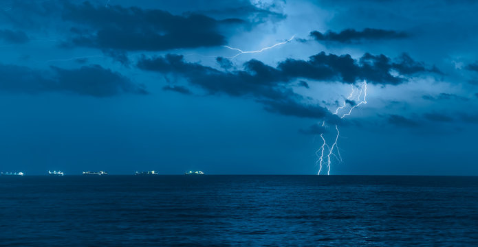 Beautiful sea landscape and storm beginning with lightning