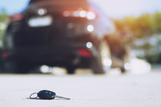 abstract lost car keys fall lying on the street concrete cement ground roadway home front yard.