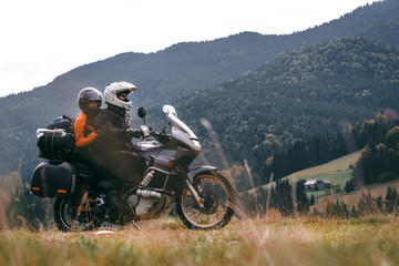 A loving couple on a touristic bike rides on a long journey together. travel, vacation. active lifestyle. View of the mountains and pine forest in the Carpathians Romania