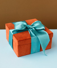 Decorative gift box with blue bow and ribbon