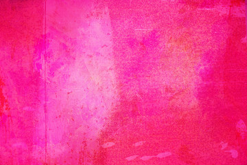 The abstract bright pink surface has a brush painted on the background for graphic design.