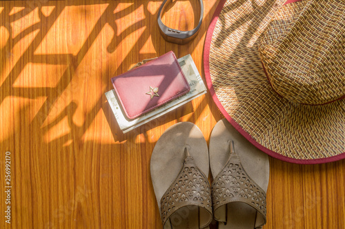 851e698ecb8 Top view beach background of essential modern women accessories in wooden  table. Flip flops