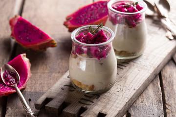 Yogurt with Ripe Dragon fruit, Pitaya or Pitahaya on wooden background, fruit healthy concept