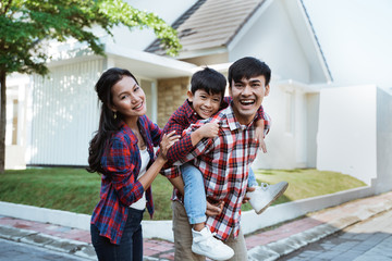 asian family standing in front of their new house together. mother father and son new home Fototapete
